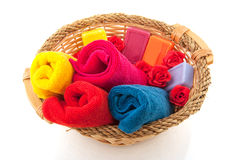 Colorful towels in cane basket. Colorful towels soap and roses in cane basket Stock Images