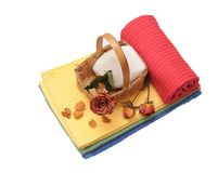 Colorful towels and dried rose Stock Image