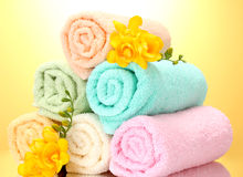 Colorful towels and flowers Stock Photos