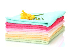 Colorful towels and flowers Royalty Free Stock Photography