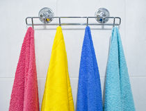 Colorful towels hanging in a bathroom. The photograph of 4 colorful towels hanging in a bathroom Stock Photo
