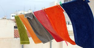 Colorful towels are hung and moved by the wind stock photo