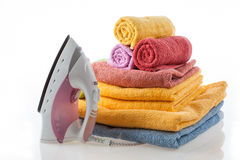 Colorful towels and iron Stock Photography