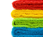 Colorful towels isolated on white background. Four colorful towels isolated on white background Stock Photos