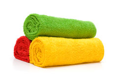 Colorful towels isolated on white background. Three colorful towels isolated on white background Royalty Free Stock Images