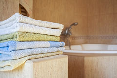 Colorful towels lie in the bathroom Stock Photos