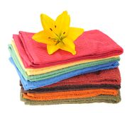 Colorful towels and lily flower Royalty Free Stock Images