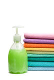 Colorful towels and liquid soap isolated Royalty Free Stock Photography