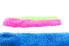 Colorful towels in rolls. On a white background Royalty Free Stock Image