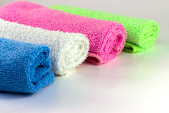 Colorful towels in rolls. On a white background Stock Images