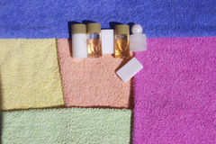 Colorful towels,Shampoo and soap Stock Photos