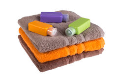 Colorful towels and small plastic bottles for travel Royalty Free Stock Image