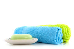 Colorful towels with soap Stock Image