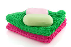 Colorful towels with soap Royalty Free Stock Photos