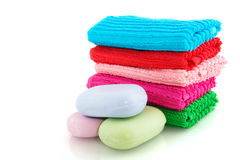Colorful towels with soap Royalty Free Stock Photography