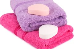 Towels and soaps. Colorful towels and soaps  on white background Stock Image