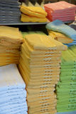 Colorful towels. Stack of colorful towels up for sale Royalty Free Stock Image