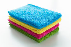 Colorful towels, stacked and isolated Stock Images