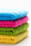 Colorful towels, stacked, isolated Stock Photography