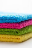 Colorful towels, stacked, isolated, vertical Royalty Free Stock Photography