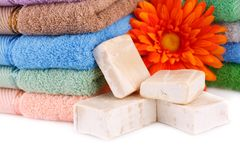 Towels, flower and soaps. Colorful towels stacks, flower and soaps closeup picture Stock Photo