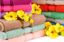 Towels. Colorful towels stacks with flowers closeup picture Royalty Free Stock Photography