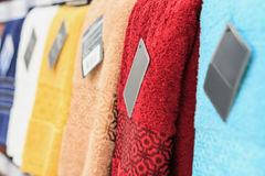 Colorful towels on supermarket shelves Royalty Free Stock Photo