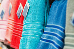 Colorful towels on supermarket shelves Stock Photo