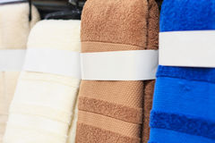 Colorful towels. On supermarket shelves background Royalty Free Stock Image