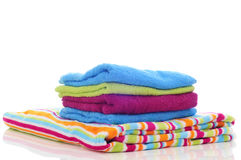 Colorful towels on a white background Stock Photos
