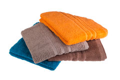 Colorful towels on a white background Stock Images