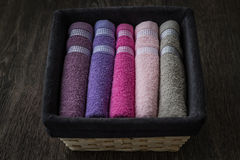 Colorful Towels in Wicker Basket Royalty Free Stock Images