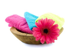 Colorful towels in a wooden bowl Stock Image