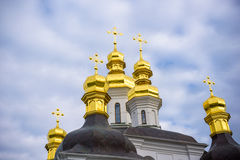 Colorful tower with onion dome and orthodox cross on top. Detail of christian church made in byzantine russian style. Sky as larg. Colorful tower with onion dome stock images
