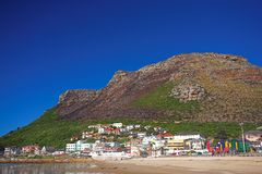 The colorful town of Muizenberg next to the sea. The colorful town of Muizenberg against the mountain next to the ocean, Western Cape, South Africa. A beach in Stock Photography