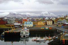 Colorful town with a port in Iceland royalty free stock photo