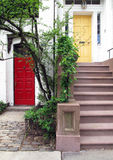 Colorful Townhouse Doors. An upscale townhouse neighborhood with colorful accent doors Stock Photo