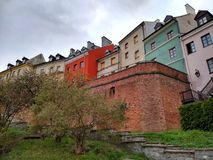 Colorful townhouses on the slope of the old town royalty free stock photos