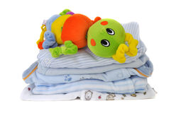 Colorful Toy on Baby Clothes Stock Photography