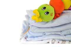 Colorful Toy on Baby Clothes Royalty Free Stock Photos