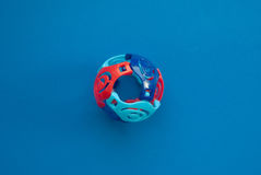 Colorful Toy ball with slits on a blue background. Hollow, fun for kids Royalty Free Stock Images