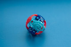 Colorful Toy ball with slits on a blue background. Hollow, fun for kids Stock Photo