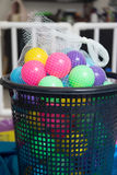 Colorful toy balls in mesh bag Royalty Free Stock Photos