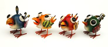 Colorful toy birds stock images