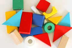 Colorful toy blocks flat lay on white background. Variety of colorful toy blocks on white background, flat lay Stock Photos