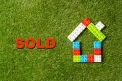 Free Colorful Toy Blocks House Word Sold Written On Grass In Real State And Property Industry Concept Stock Photos - 134456453