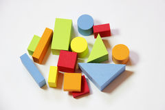 Colorful toy bricks. In various shapes like rectangle, circles and triangles stock image
