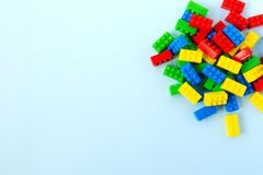 Colorful toy building blocks. On blue background royalty free stock photography