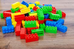 Colorful toy building blocks. On wood background royalty free stock photography