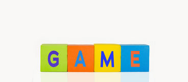 Colorful toy building blocks. In a line text game royalty free stock photos